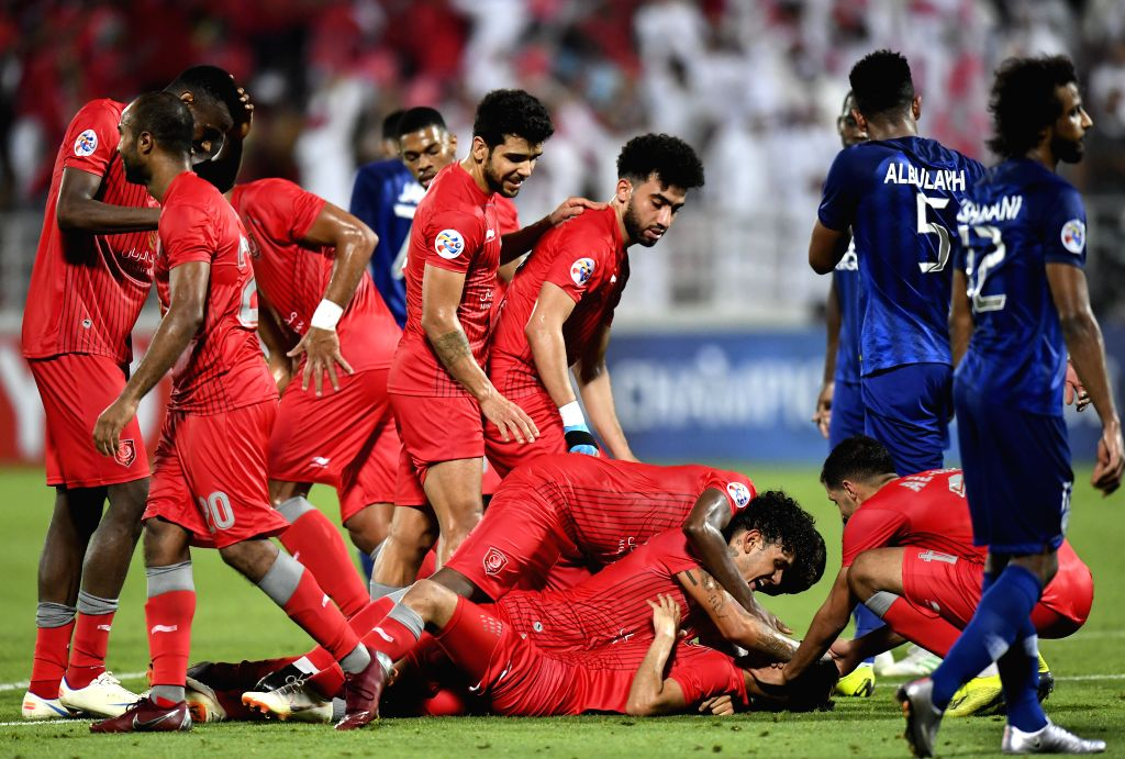 DOHA, May 21, 2019 - Players of Al Duhail celebrate after scoring the opening goal during the AFC Champions League group C soccer match between Qatar's Al Duhail and Saudi Arabia's Al Hilal at ...