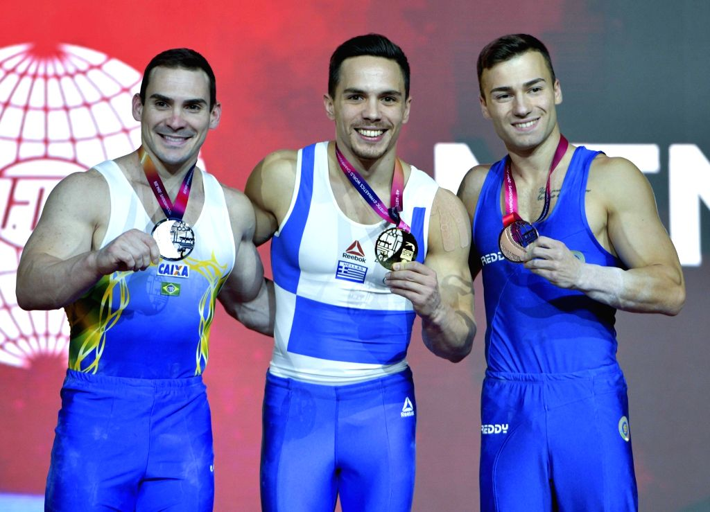 DOHA, Nov. 3, 2018 - Gold Medalist Eleftherios Petrounias (C) of Greece, silver medalist Arthur Zanetti (L) of Brazil and bronze medalist Marco Lodadio of Italy pose during the awarding ceremony of ...