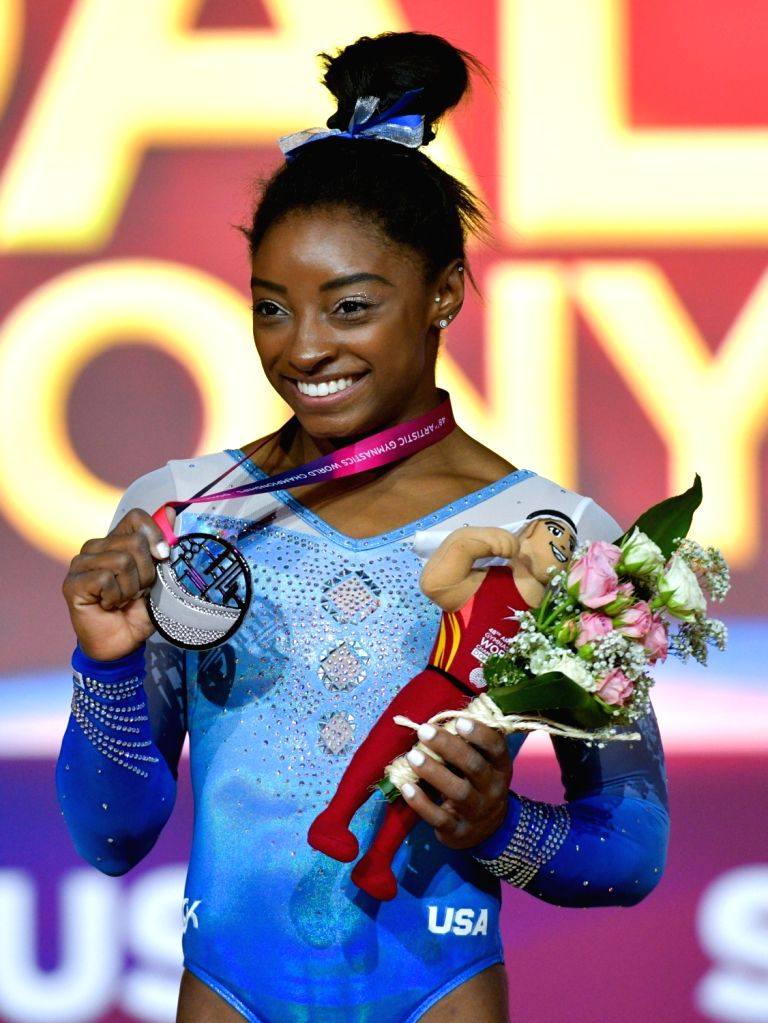 DOHA, Nov. 3, 2018 - Silver medalist Simone Biles of the United States poses on the podium after the women's uneven bars final at the 2018 FIG Artistic Gymnastics World Championships in Doha, capital ...