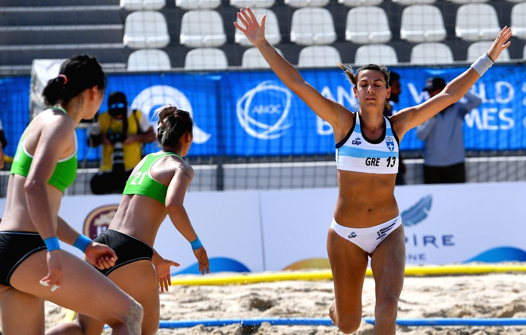 DOHA, Oct. 12, 2019 - Ntafina Dimitri (R) of Greece celebrates goal during the women's beach handball preliminary round Group B match between China and Greece at the 1st ANOC World Beach Games in ...
