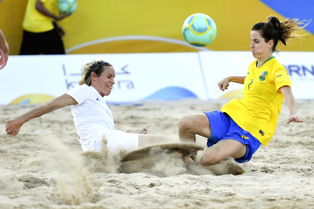 DOHA, Oct. 16, 2019 - Barbara Colodetti (R) of Brazil vies with Wendy Irene Martin (L) of Great Britain during the women's beach soccer semifinal at the 1st ANOC World Beach Games in Doha, capital of ...