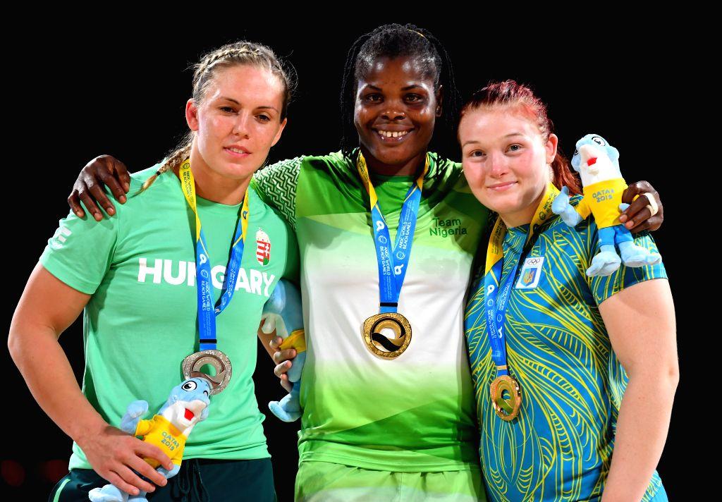 DOHA, Oct. 16, 2019 - Gold medalist Blessing Joy Onyebuchi (C) of Nigeria, silver medalist Zsanett Nemeth (L) of Hungary and bronze medalist Iryna Pasichnyk of Ukraine pose for photos during the ...
