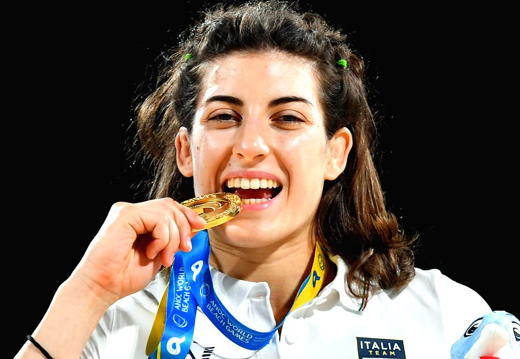 DOHA, Oct. 16, 2019 - Gold medalist Francesca Indelicato of Italy poses for photos during the awarding ceremony of the women's beach wrestling 60kg at the 1st ANOC World Beach Games Qatar 2019 in ...