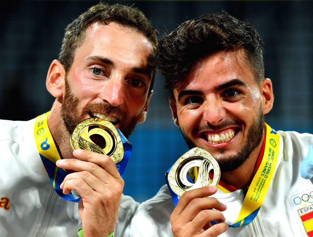 DOHA, Oct. 16, 2019 - Gold medalists Gerard Rodriguez (L)/Antonio Ramos of Spain pose for photos during the awarding ceremony of the men's doubles of beach tennis at the 1st ANOC World Beach Games in ...