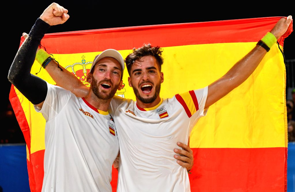 DOHA, Oct. 16, 2019 - Gold medalists Gerard Rodriguez (L)/Antonio Ramos of Spain celebrate after winning the men's doubles of beach tennis at the 1st ANOC World Beach Games in Doha, capital of Qatar, ...