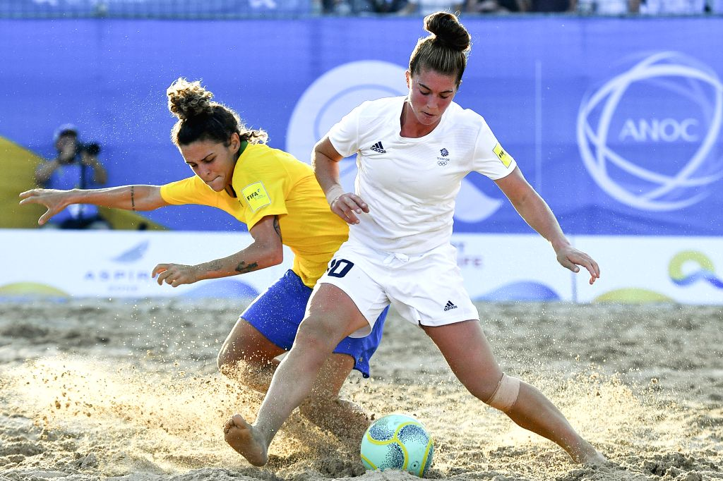 DOHA, Oct. 16, 2019 - Leticia Villar Pais (L) of Brazil vies with Molly Lacey Clark (R) of Great Britain during the women's beach soccer semifinal at the 1st ANOC World Beach Games in Doha, capital ...