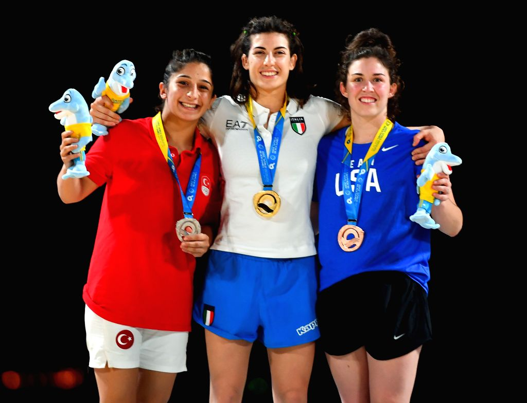 DOHA, Oct. 16, 2019 - Silver medalist Mehlika Ozturk of Turkey, gold medalist Francesca Indelicato of Italy and bronze medalist Shauna Kemp of the United States (from L to R) pose for photos during ...