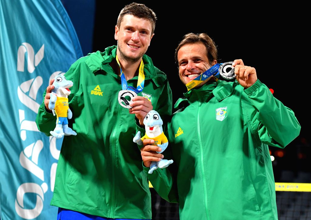 DOHA, Oct. 16, 2019 - Silver medalists Andre Baran (L)/Vinicius Font of Brazil pose for photos during the awarding ceremony of the men's doubles of beach tennis at the 1st ANOC World Beach Games in ...