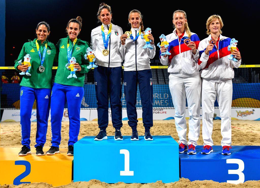 DOHA, Oct. 16, 2019 - Silver medalists Joana Cortez/Rafaella Miiller of Brazil, gold medalists Flaminia Daina/Nicole Nobile of Italy and bronze medalists Irina Glimakova/Daria Churakova of Russia ...