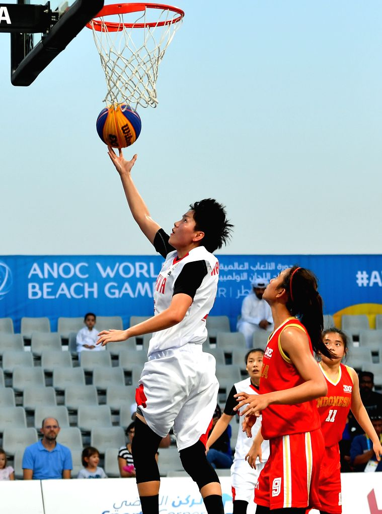 DOHA, Oct. 16, 2019 - Wang Haimei (1st L) of China shoots during the 3x3 women's Team Group B match between China and Indonesia at the 1st ANOC World Beach Games Qatar 2019 in Doha, capital of Qatar, ...
