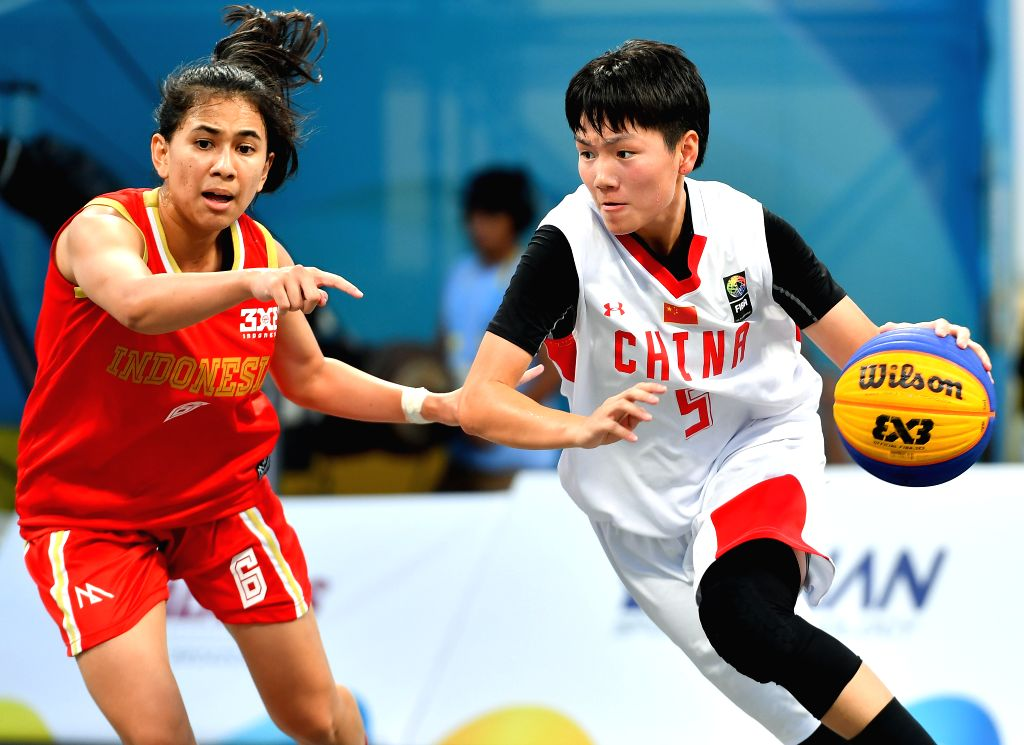 DOHA, Oct. 16, 2019 - Wang Haimei (R) of China vies with Christie  Apriyani of Indonesia during the 3x3 women's Team Group B match between China and Indonesia at the 1st ANOC World Beach Games Qatar ...