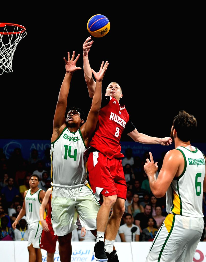 DOHA, Oct. 17, 2019 - Abramovskii Daniil (R, top) of Russia competes against Parcial Bispo Matheus (L, top) of Brazil during the final of the 3x3 men's basketball at the 1st ANOC World Beach Games ...