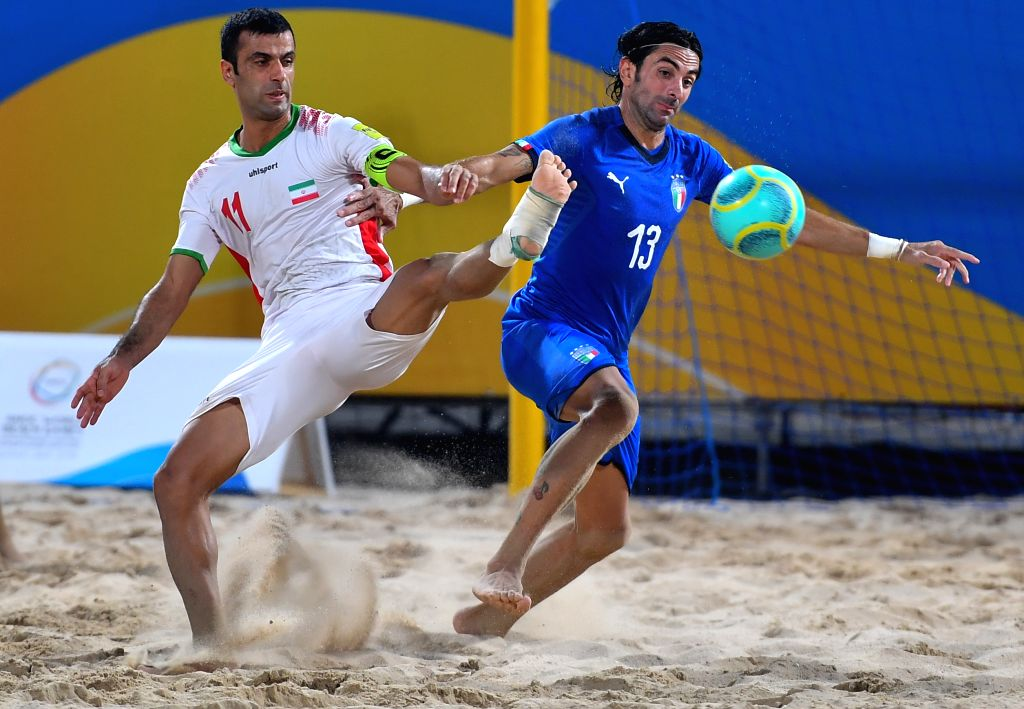 DOHA, Oct. 17, 2019 - Ahmadzadeh Mohammad (L) of Iran vies with Chiavaro Alfio Luca of Italy during the men's Beach Soccer Bronze Medal match between Iran and Italy at the 1st ANOC World Beach Games ...