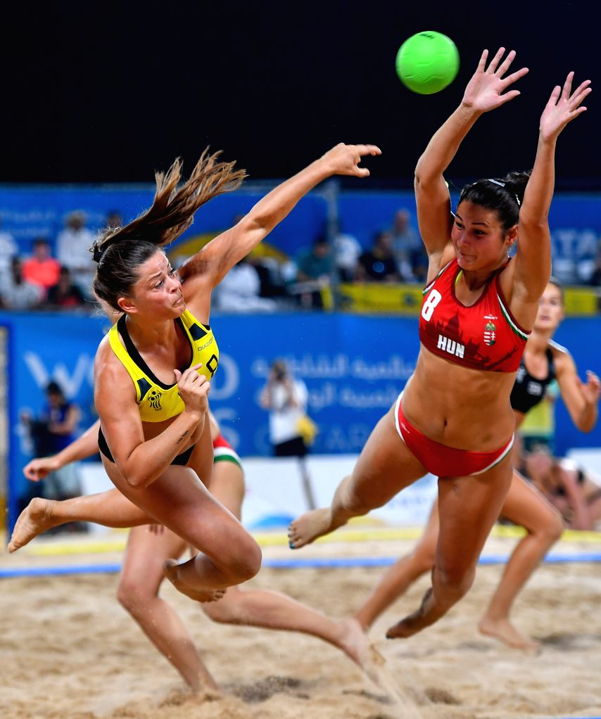 DOHA, Oct. 17, 2019 - Fuglsbjerg Melanie (L) of Denmark vies with Toth Emese Szilvia of Hungary during the women's Beach Handball final between Hungary and Denmark at the 1st ANOC World Beach Games ...