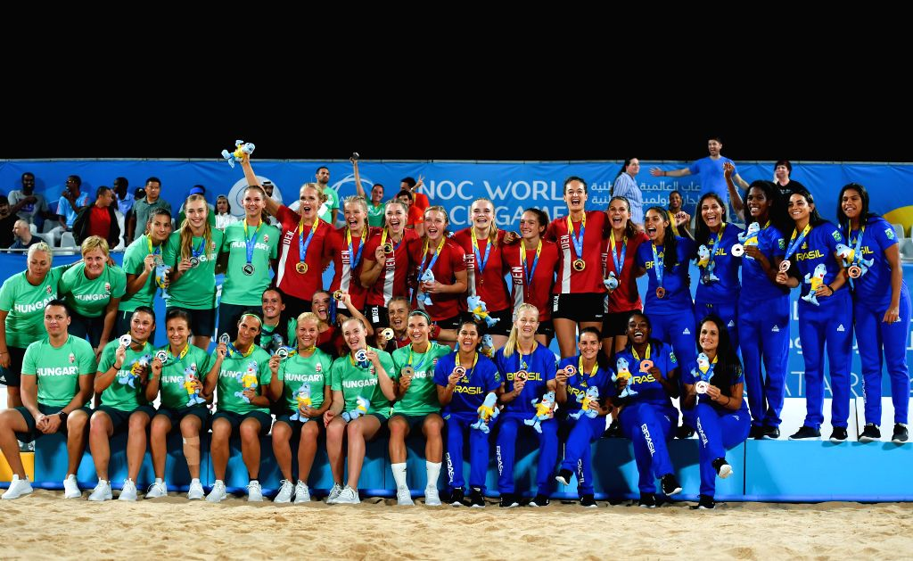 DOHA, Oct. 17, 2019 - Gold medalist players of Denmark (in red), silver medalist players of Hungary (in green) and bronze medalist players of Brazil (in blue) celebrate during the awarding ceremony ...