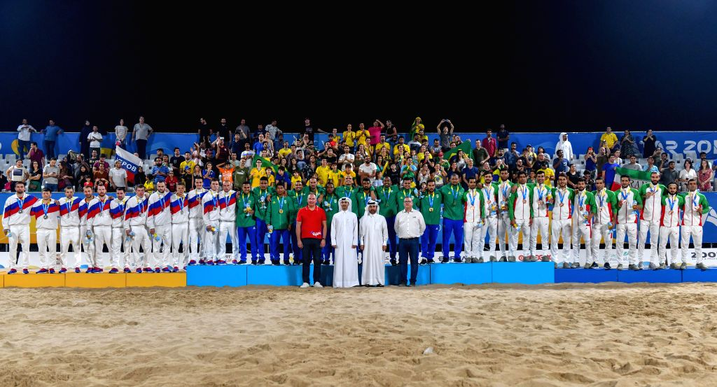 DOHA, Oct. 17, 2019 - Gold medalist Team Brazil (C), silver medalist Team Russia (L) and bronze medalist Team Iran (R) pose for photos during the awarding ceremony of the men's Beach Soccer at the ...