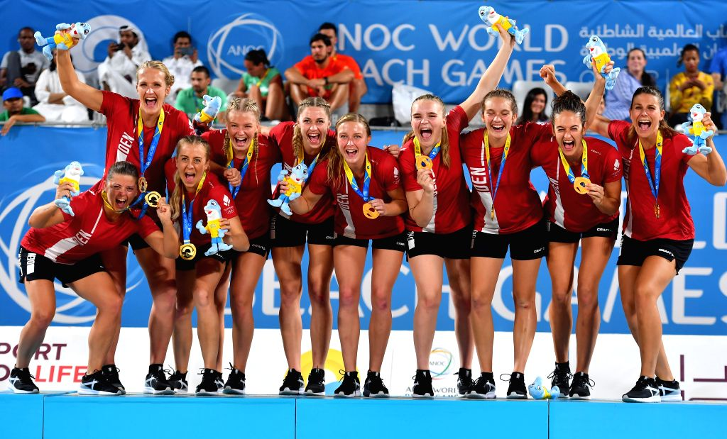 DOHA, Oct. 17, 2019 - Gold medalists, players of Denmark, celebrate during the awarding ceremony of the women's beach handball at the 1st ANOC World Beach Games Qatar 2019 in Doha, capital of Qatar, ...