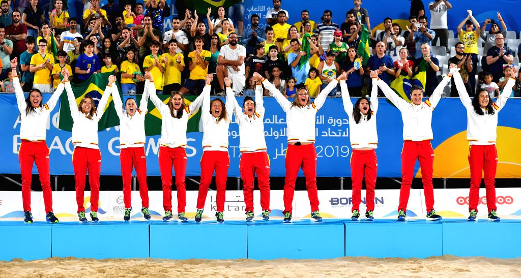 DOHA, Oct. 17, 2019 - Gold medalists, players of Spain, celebrate during the awarding ceremony of the women's beach soccer at the 1st ANOC World Beach Games in Doha, capital of Qatar, Oct. 16, 2019.