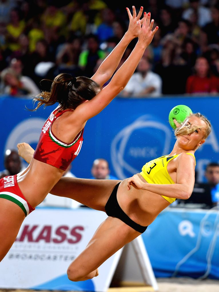 DOHA, Oct. 17, 2019 - Kristensen Line Gyldenlove (R) of Denmark vies with Speth Evelin of Hungary during the women's Beach Handball final between Hungary and Denmark at the 1st ANOC World Beach Games ...