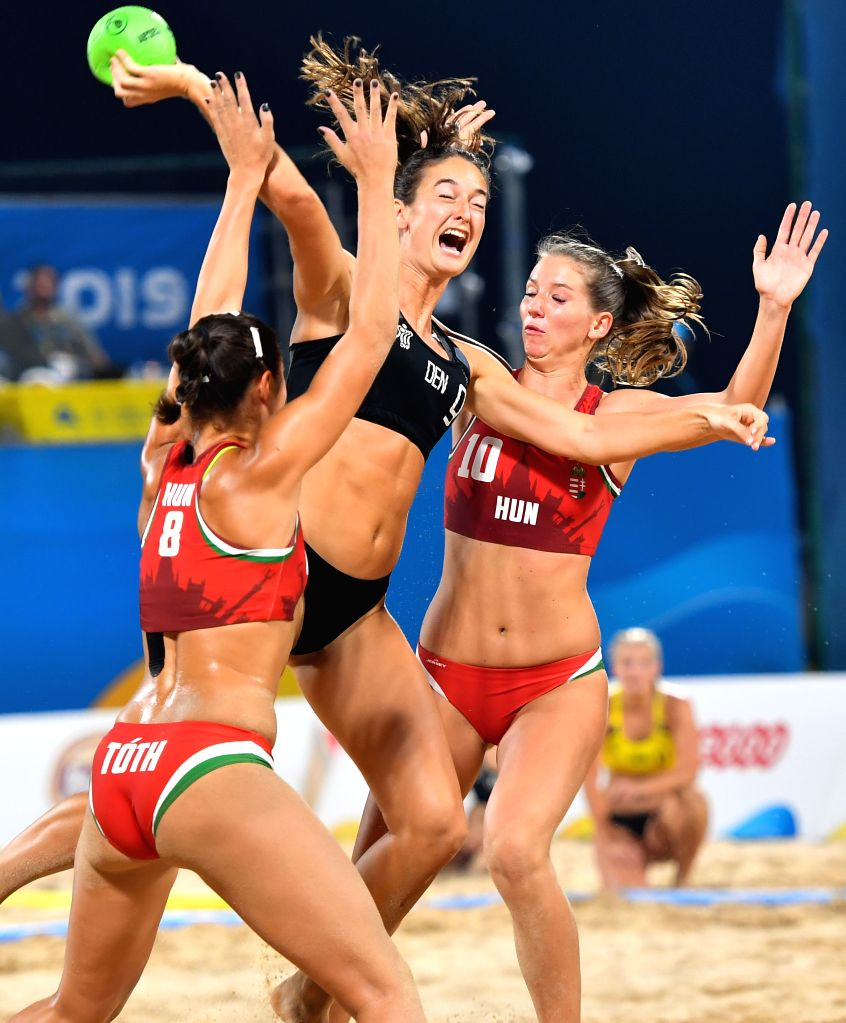 DOHA, Oct. 17, 2019 - Laerke Frederikke Buhl (C) of Denmark competes during the women's Beach Handball final between Hungary and Denmark at the 1st ANOC World Beach Games Qatar 2019 in Doha, capital ...