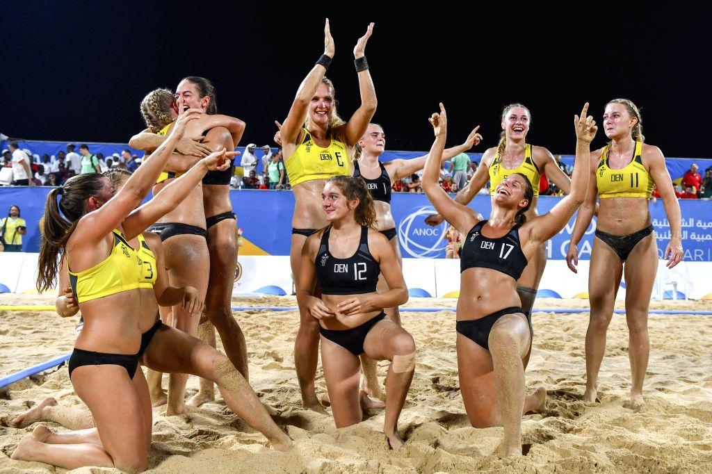 DOHA, Oct. 17, 2019 - Team Denmark celebrates after winning the women's Beach Handball final between Hungary and Denmark at the 1st ANOC World Beach Games Qatar 2019 in Doha, capital of Qatar, on ...