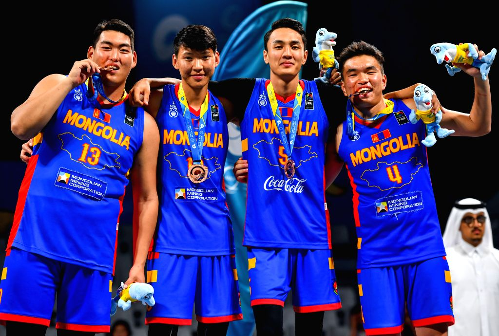 DOHA, Oct. 17, 2019 - Team Mongolia poses for photos after winning the bronze medal during the awarding ceremony of the 3x3 men's basketball at the 1st ANOC World Beach Games Qatar 2019 in Doha, ...
