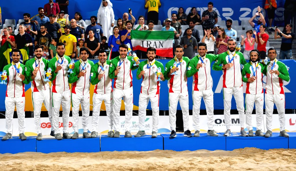 DOHA, Oct. 17, 2019 - Team of Iran celebrates winning the bronze medal during the men's Beach Soccer Bronze Medal match between Iran and Italy at the 1st ANOC World Beach Games Qatar 2019 in Doha, ...