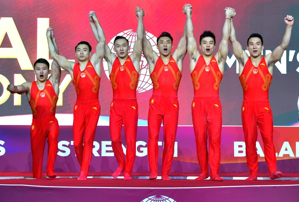 DOHA, Oct. 30, 2018 - Members of team China celebrate on the podium after winning the Men's Team Final at the 2018 FIG Artistic Gymnastics Championships in Doha, capital of Qatar, Oct. 29, 2018.  ...