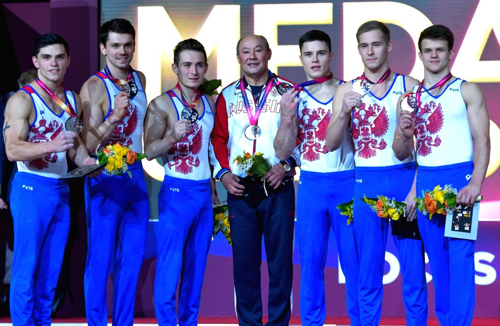 DOHA, Oct. 30, 2018 - Members of team Russia celebrate on the podium after winning the silver medal in the Men's Team Final at the 2018 FIG Artistic Gymnastics Championships in Doha, capital of ...