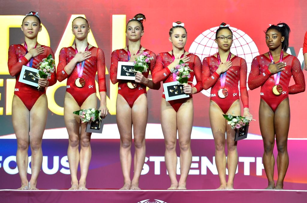 DOHA, Oct. 31, 2018 - Members of team America celebrate on the podium after winning the gold medal in the women's team final at the 2018 FIG Artistic Gymnastics World Championships in Doha, capital ...