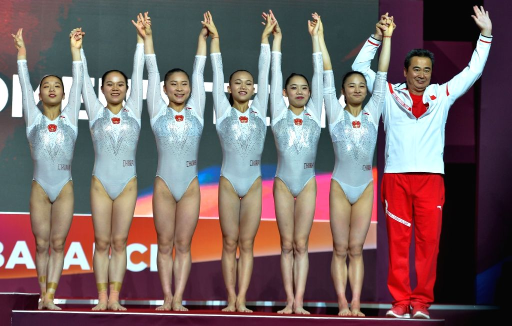 DOHA, Oct. 31, 2018 - Members of team China celebrate on the podium after winning the bronze medal in the women's team final at the 2018 FIG Artistic Gymnastics World Championships in Doha, capital ...