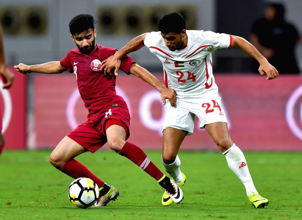 DOHA, Sep. 12, 2018 - Islam Batran (R) of Palestine vies with Ahamad Moein Doozandeh of Qatar during an international friendly soccer match between Qatar and Palestine at the Khalifa International ...