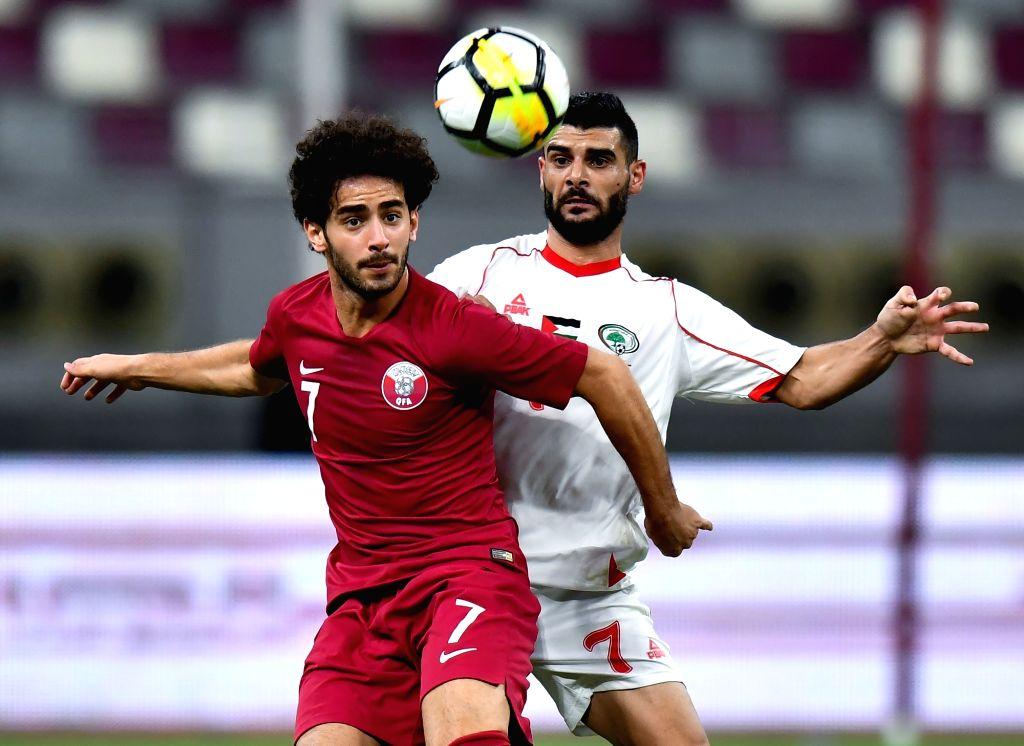 DOHA, Sep. 12, 2018 - Musab Battat (R) of Palestine vies with Ahmed Alaaeldin of Qatar during an international friendly soccer match between Qatar and Palestine at the Khalifa International Stadium ...