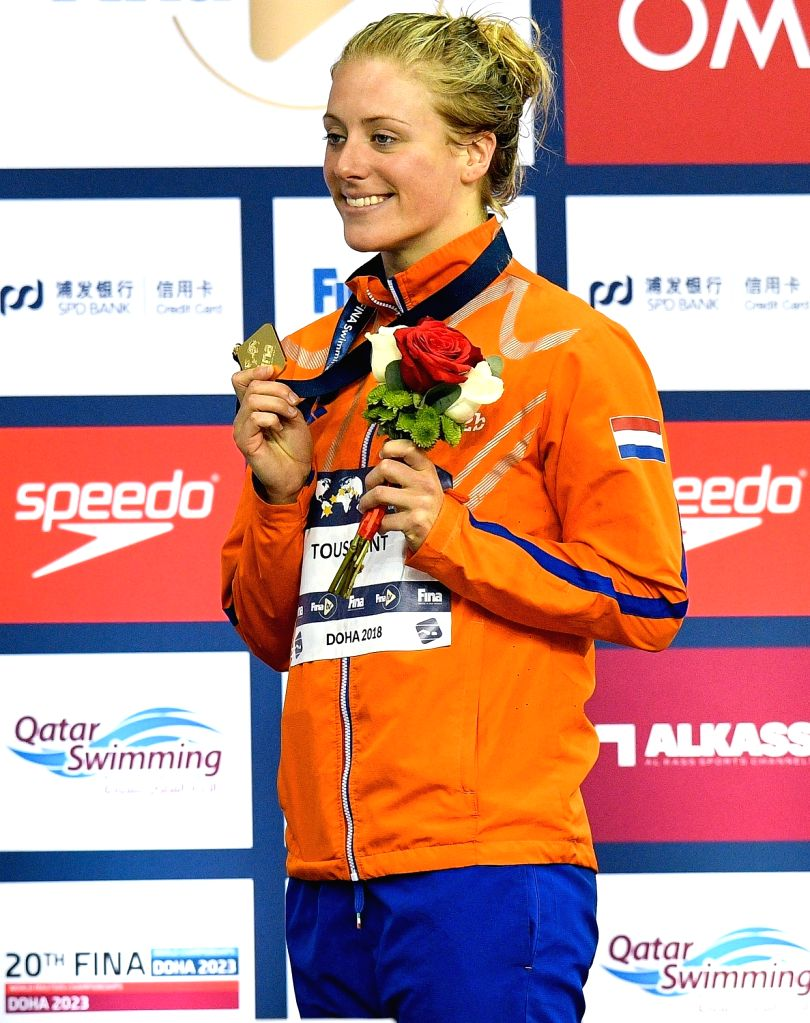 DOHA, Sept.14, 2018 - Kira Toussaint of the Netherlands shows her gold medal during the awarding ceremony for the Women's 50m Backstroke Final of FINA Swimming World Cup Doha 2018 in Doha, capital of ...