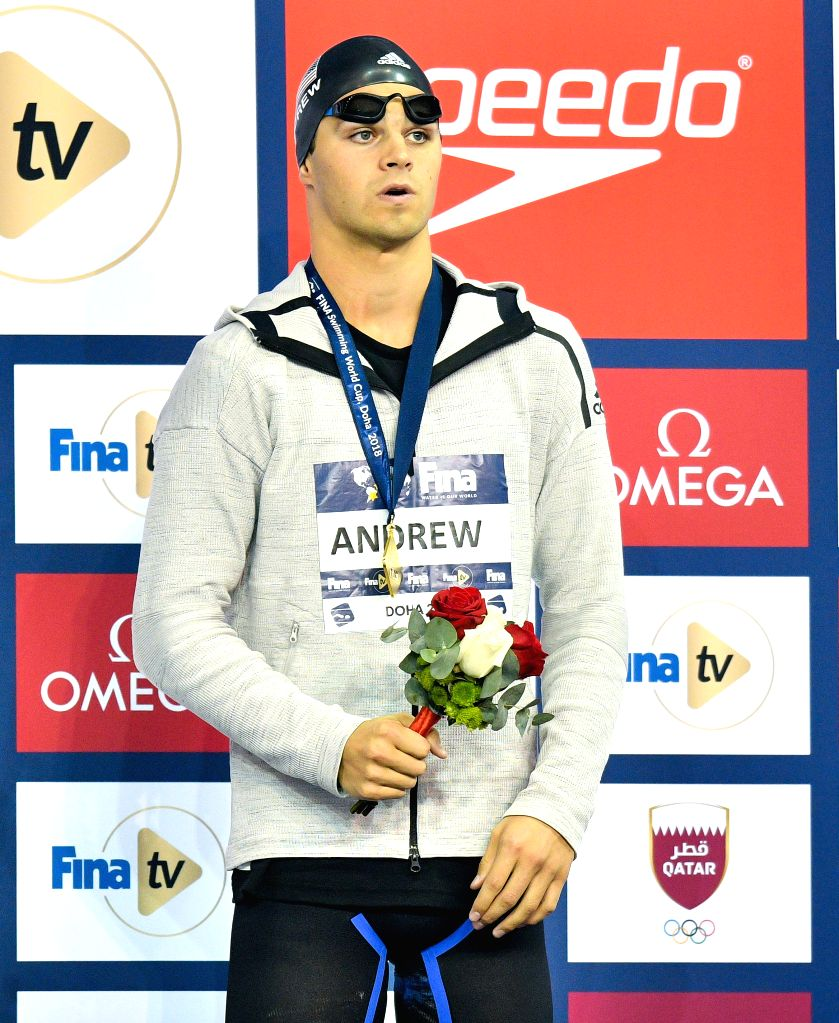 DOHA, Sept. 15, 2018 - Men's 50m Backstroke gold medalist Michael Andrew of the United States reacts on the podium of FINA Swimming World Cup Doha 2018 in Doha, capital of Qatar on Sept. 14, 2018.