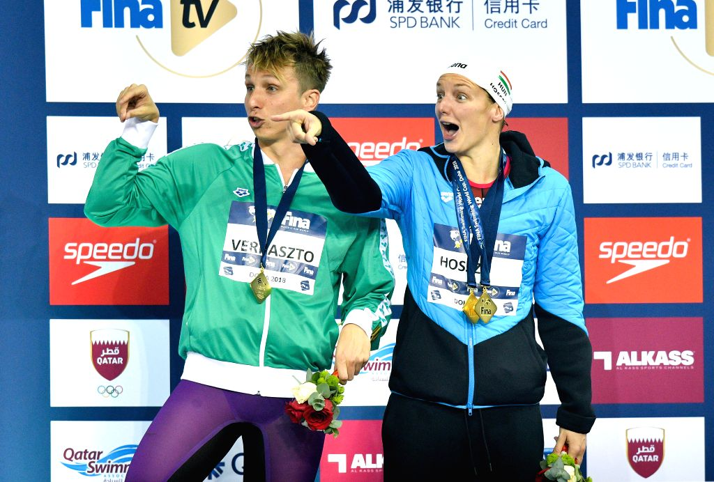 DOHA, Sept. 16, 2018 - Men's 400m Individual Medley gold medalist David Verraszto (L) of Hungary and Women's 800m Freestyle gold medalist Katinka Hosszu (R) of Hungary react on the awarding ceremony ...