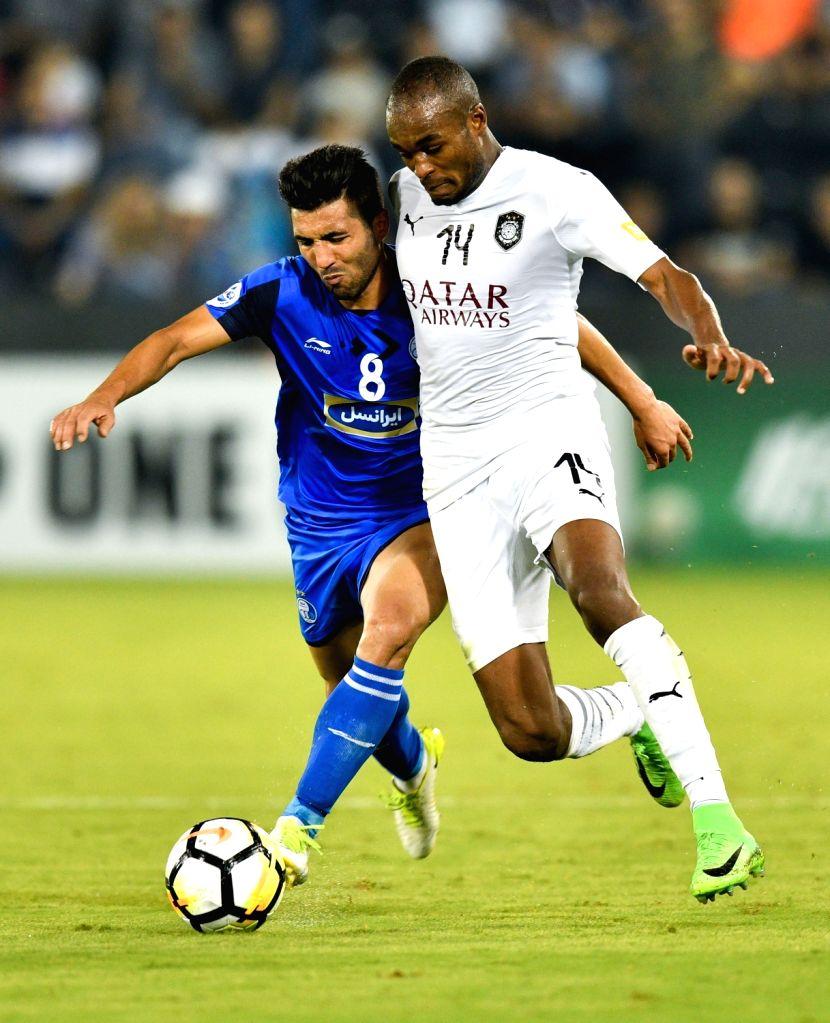 DOHA, Sept. 18, 2018 - Abdelkarim Hassan (R) of Al Sadd vies with Farshid Esmaeili of Esteghlal FC during the AFC Asian Champions League quarterfinal second leg football match between Qatar's Al Sadd ... - Abdelkarim Hassan