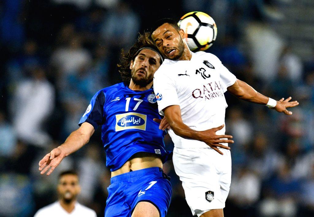 DOHA, Sept. 18, 2018 - Hamid Ismaeil (R) of Al Sadd vies with Humam Tareq of Esteghlal FC during the AFC Asian Champions League quarterfinal second leg football match between Qatar's Al Sadd and ...