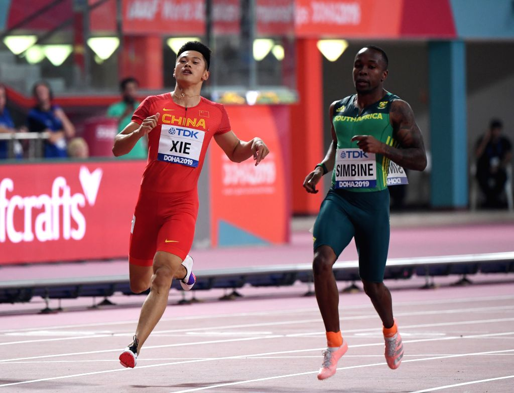 DOHA, Sept. 27, 2019 - China's Xie Zhenye (L) competes during the men's 100m heat at the 2019 IAAF World Athletics Championships in Doha, Qatar, on Sept. 27, 2019.