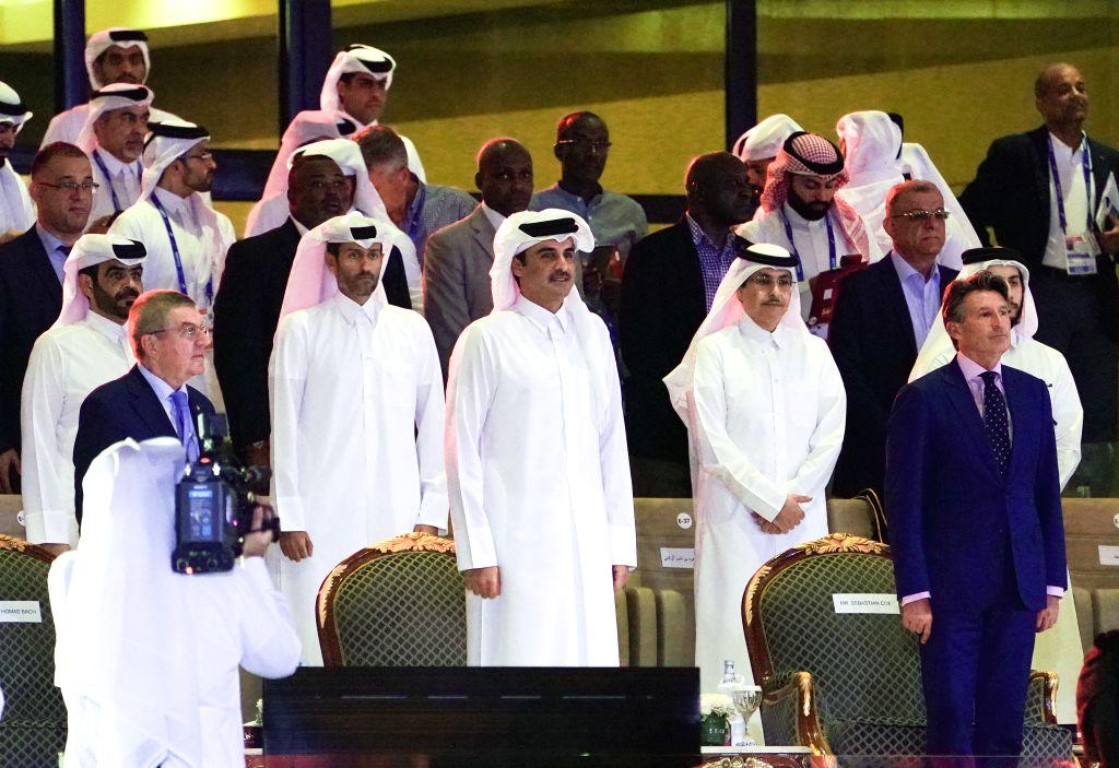 DOHA, Sept. 28, 2019 - Qatari Emir Sheikh Tamim Bin Hamad Al-Thani (C), IAAF President Sebastian Coe (R) and IOC President Thomas Bach (L) attend the opening ceremony of 2019 IAAF World Athletics ...