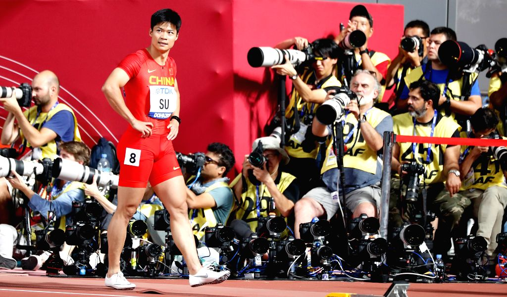 DOHA, Sept. 28, 2019 - Su Bingtian (front) of China walks off the track after the men's 100m heat at the 2019 IAAF World Athletics Championships in Doha, Qatar, Sept. 27, 2019.