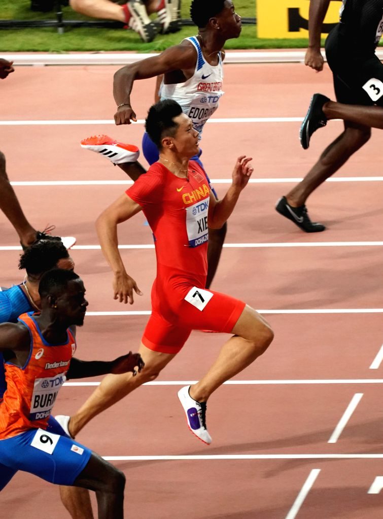 DOHA, Sept. 28, 2019 - Xie Zhenye (C) of China competes during the men's 100m heat at the 2019 IAAF World Athletics Championships in Doha, Qatar, Sept. 27, 2019.