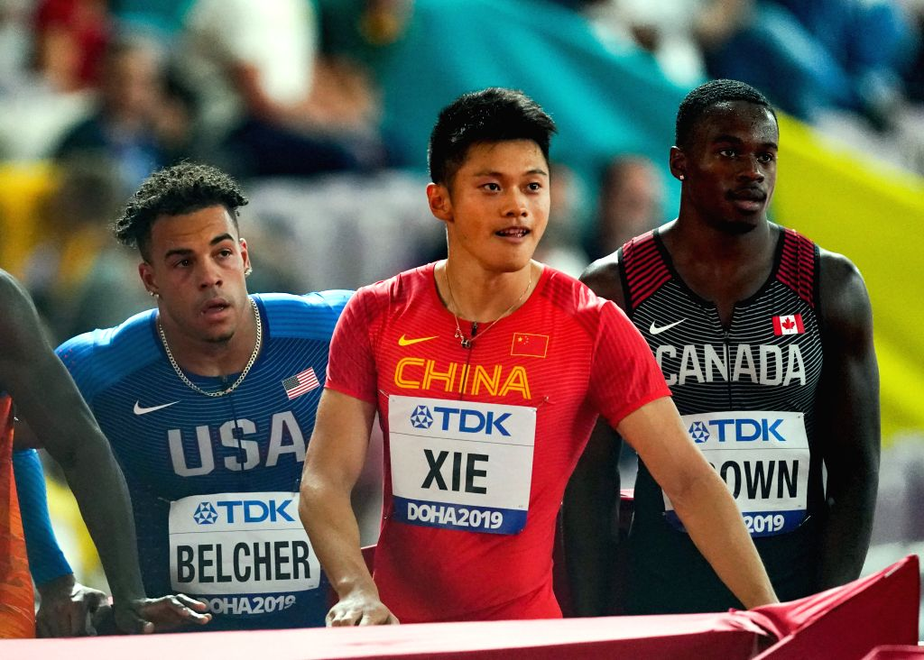 DOHA, Sept. 28, 2019 - Xie Zhenye (C) of China reacts after the men's 100m heat at the 2019 IAAF World Athletics Championships in Doha, Qatar, Sept. 27, 2019.
