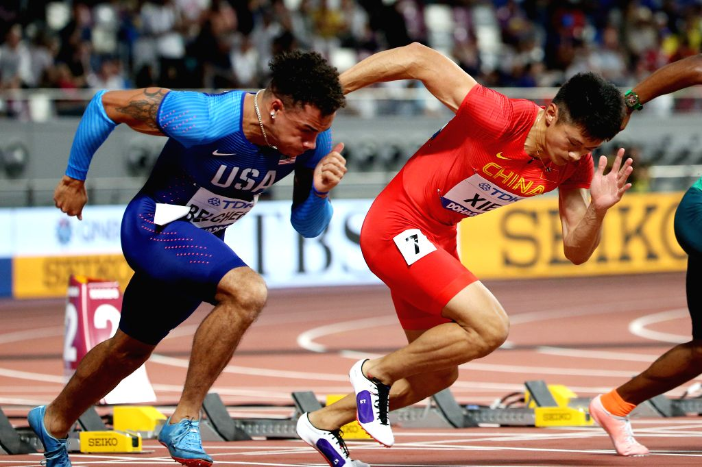 DOHA, Sept. 28, 2019 - Xie Zhenye (R) of China competes during the men's 100m heat at the 2019 IAAF World Athletics Championships in Doha, Qatar, Sept. 27, 2019.