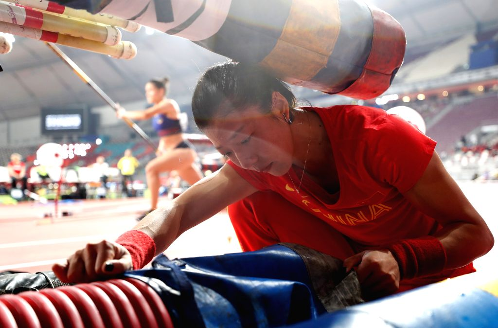 DOHA, Sept. 28, 2019 - Xu Huiqin of China packs up her equipments after the qualification round of women's pole vault at the 2019 IAAF World Athletics Championships in Doha, Qatar, Sept. 27, 2019.