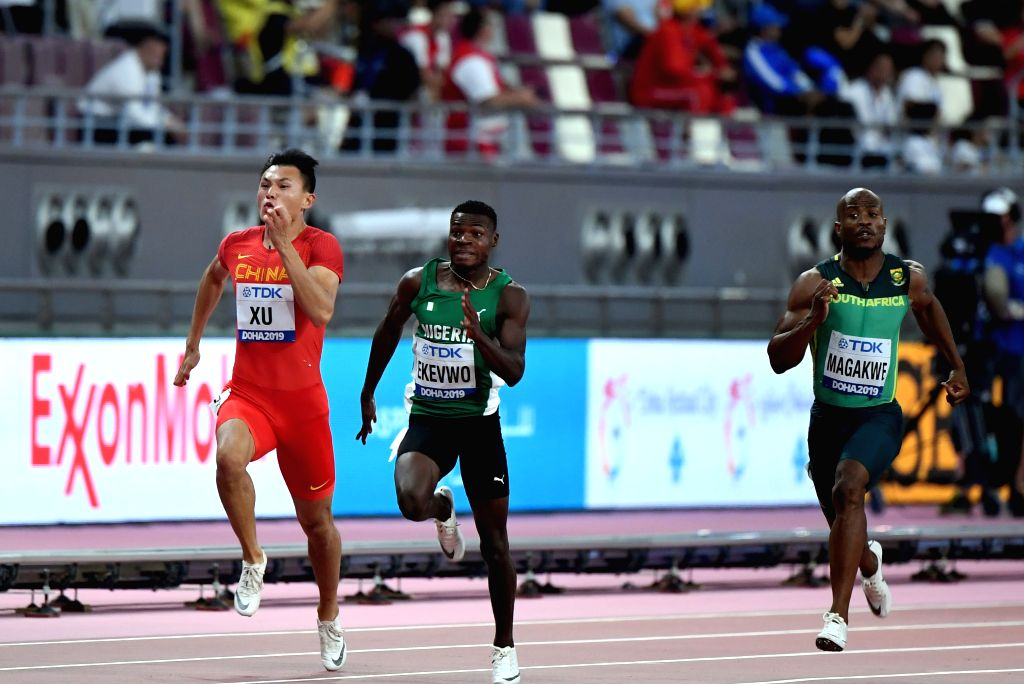 DOHA, Sept. 28, 2019 - Xu Zhouzheng (L) of China competes during the men's 100m heat at the 2019 IAAF World Athletics Championships in Doha, Qatar, Sept. 27, 2019.