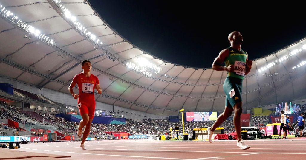 DOHA, Sept. 28, 2019 - Xu Zhouzheng (L) of China reacts after the men's 100m heat at the 2019 IAAF World Athletics Championships in Doha, Qatar, Sept. 27, 2019.