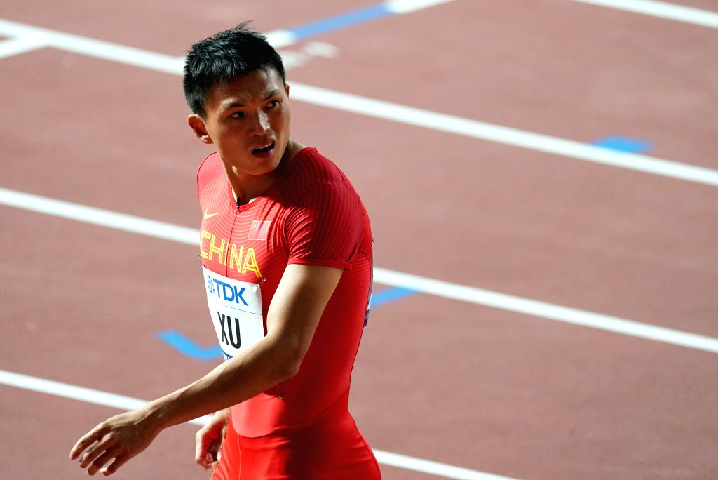 DOHA, Sept. 28, 2019 - Xu Zhouzheng of China reacts after the men's 100m heat at the 2019 IAAF World Athletics Championships in Doha, Qatar, Sept. 27, 2019.