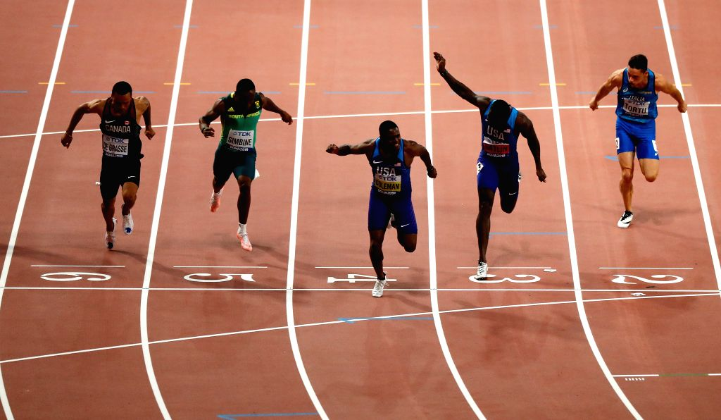 DOHA, Sept. 29, 2019 - Christian Coleman (C) of the United States sprints with his compatriot Justin Gatlin (2nd R) and Andre De Grasse of Canada (1st L) during the men's 100m final at the 2019 IAAF ...
