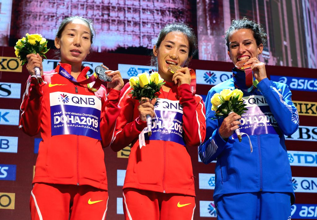 DOHA, Sept. 29, 2019 - Gold medalist Liang Rui (C) of China, silver medalist Li Maocuo (L) of China and bronze medalist Eleonora Anna Giorgi of Italy pose for pictures at the awarding ceremony of ...